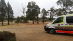 An overcast day as the ambulance sits infron of the station