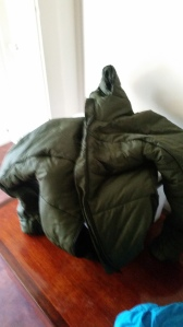 A high loft jacket, made similar to a sleeping bag, very warm not recommended for high activity or areas where you will frequently go inside to oursite. Well worth it if your standing by on a scene for hours on end or located in some of the colder regions of the country.